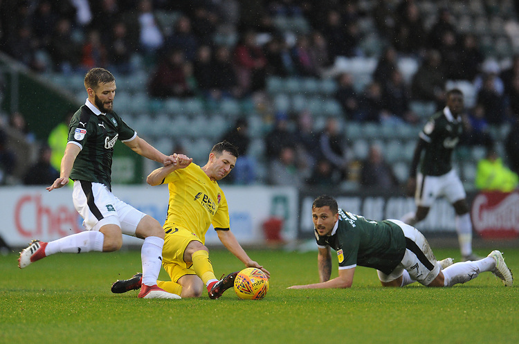 Fleetwood Town's Jason Holt vies for possession with Plymouth Argyle's JamieNess<br /> <br /> Photographer Kevin Barnes/CameraSport<br /> <br /> The EFL Sky Bet League One - Plymouth Argyle v Fleetwood Town - Saturday 24th November 2018 - Home Park - Plymouth<br /> <br /> World Copyright © 2018 CameraSport. All rights reserved. 43 Linden Ave. Countesthorpe. Leicester. England. LE8 5PG - Tel: +44 (0) 116 277 4147 - admin@camerasport.com - www.camerasport.com