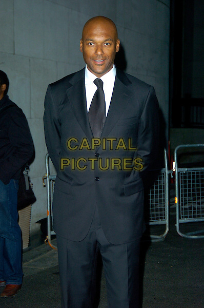 COLIN SLAMON.The Gift of Life Ball in aid of the Afro Caribbean Leukaemia Trust at the Intercontinental Hotel, Park Lane, London, England..September 22nd 2007.full length 3/4 black suit .CAP/CAN.©Can Nguyen/Capital Pictures