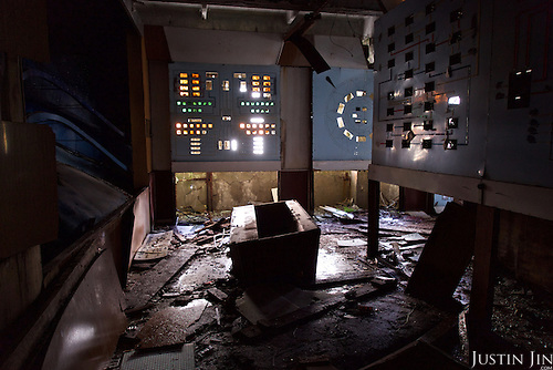 The training room at the &quot;Russian Woodpecker&quot;, an advanced Soviet radio weapon, stands near the decommissioned Chernobyl power station reactor number 4. <br /> <br /> Дуга-3 (Duga-3) was a Soviet over-the-horizon (OTH) radar system used as part of the Soviet ABM early-warning network. The system operated from July 1976 to December 1989. Two operational Duga radars were deployed, one near Chernobyl and Chernihiv in what was then called the Ukrainian SSR (present-day Ukraine), the other in eastern Siberia.<br /> <br /> The Duga systems were extremely powerful, over 10 MW in some cases, and broadcast in the shortwave radio bands. They appeared without warning, sounding like a sharp, repetitive tapping noise at 10 Hz,[1] which led to it being nicknamed by shortwave listeners the Russian Woodpecker. The random frequency hops disrupted legitimate broadcast, amateur radio, commercial aviation communications, utility transmissions, and resulted in thousands of complaints by many countries worldwide. <br /> <br /> 30 years on, the Chernobyl power plant is still heavily contaminated, unfit for human life. <br /> <br /> The Chernobyl nuclear disaster happened on 26 April 1986.