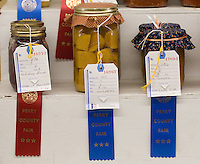 Canned goods are decorated with winning ribbons at the Perry County Fair in New Lexington, Ohio.<br />