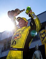 Oct 16, 2016; Ennis, TX, USA; NHRA funny car driver Matt Hagan celebrates after winning the Fall Nationals at Texas Motorplex. Mandatory Credit: Mark J. Rebilas-USA TODAY Sports