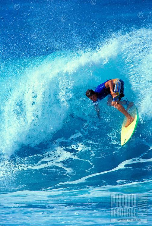Surfer Josh Hottenstein surfing in the Hi-Tech Lopez Surf Bash in Hookipa, Maui