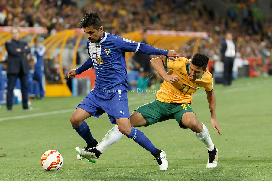 FAISAL ZAYED ALHARBI of Kuwait and Massimo LUONGO of Australia compete for the ball in match 1 of the 2015 AFC Asian Cup at the Melbourne Rectangular Stadium on 9 January 2015. Australia def Kuwait 4-1