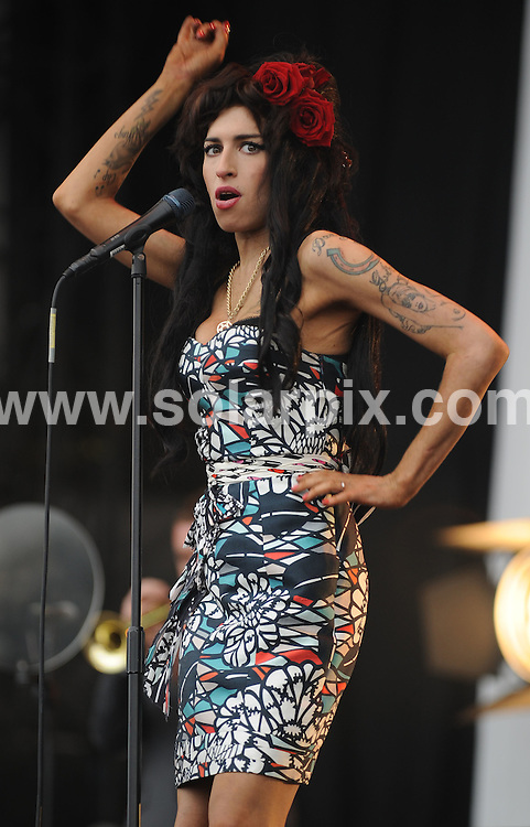 **ALL ROUND PICTURES FROM SOLARPIX.COM**.**WORLDWIDE SYNDICATION RIGHTS**.Amy Winehouse performs live at V Festival, Chelmsford, UK. 17th August 2008..This pic: Amy Winehouse..JOB REF: 7040 SSD     DATE: 17_08_2008.**MUST CREDIT SOLARPIX.COM OR DOUBLE FEE WILL BE CHARGED* *UNDER NO CIRCUMSTANCES IS THIS IMAGE TO BE REPRODUCED FOR ANY ONLINE EDITION WITHOUT PRIOR PERMISSION*