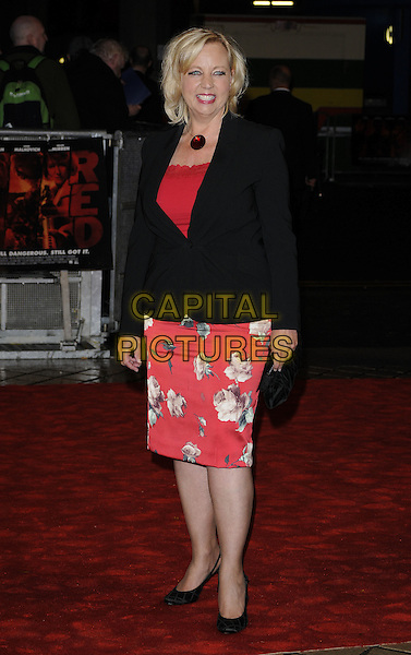 DEBORAH MEADEN.Attending the UK Film Premiere of 'Red' at the Royal Festival Hall, London, England, UK..October 19th 2010.full length red top lace black jacket floral print skirt necklace .CAP/CAN.©Can Nguyen/Capital Pictures.