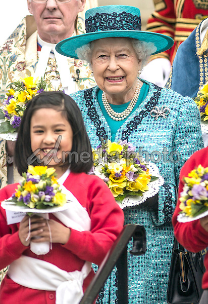 24 March 2016 - Queen Elizabeth II stands with local children on the steps of St Georges Chapel in Windsor following the traditional Maundy Thursday service where she distributed money to 180 people 90 men and 90 women symbolising her age. The Maundy service took place in St George's Chapel in Windsor the first time since 1959 that it has been held at the Royal Chapel. Maundy Thursday is the Christian holy day falling on the Thursday before Easter. It commemorates the Maundy and Last Supper of Jesus Christ with the Apostles. The Queen commemorates Maundy by offering 'alms' to senior citizens, retired pensioners recommended by clergy and ministers of all denominations, in recognition of service to the Church and to the local Community. During the Royal Maundy Service The Queen will distribute the Maundy money to 90 men and 90 women, one for each of The Queen's 90 years. Each recipient receives two purses, one red and one white. Recipients this year are drawn, not from a single diocese as is normally the case, but from across the country. This year the Red Purse contains a £5 coin, commemorating The Queen's ninetieth birthday, and a 50p coin commemorating the nine hundred and fiftieth anniversary of the Battle of Hastings. Both coins have been minted in 2016. Historically, the sum of £5.50 in the Red Purse is made up of £3 for clothing, £1.50 in lieu of provisions and £1 for the redemption of the Sovereign's gown which, before Tudor times, used to be divided between the Recipients. The White Purse contains uniquely minted Maundy Money. This takes the form of one, two, three and four silver penny pieces, the sum of which equals the number of years of the Monarch's age. This year ninety pennies of silver coins (9 sets of 10p per set) will be distributed. Royal Maundy is one of the most ancient ceremonies retained in the Church of England. Photo Credit: ALPR/AdMedia