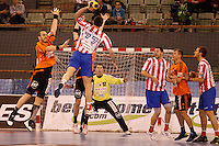 25.03.2012 MADRID, SPAIN -  EHF Champions League match played between BM At. Madrid vs Kadetten Schaffhausen (26-30) at Palacio Vistalegre stadium. the picture show Arunas Vaskevicius (Kadetten Schaffhausen player) and  Kiril Lazarov (BM Atletico de Madrid)