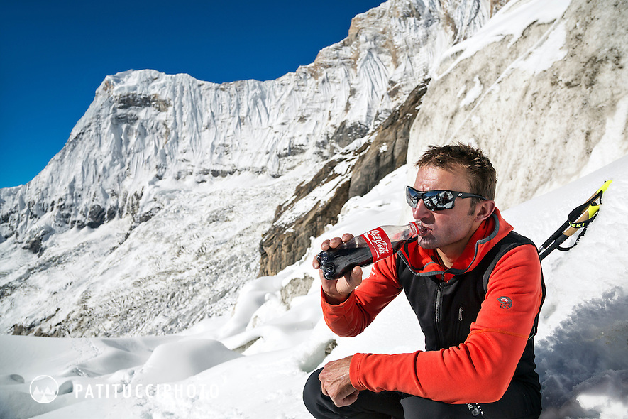 Ueli Steck returned to Nepal and the Annapurna south face in 2013 which he climbed solo, without oxygen, in one 28 hour alpine push, via a new route. The trip was his third attempt to climb the 8000 meter peak. Ueli on the glacier drinking a Coca Cola where he connected with friends during his descent.