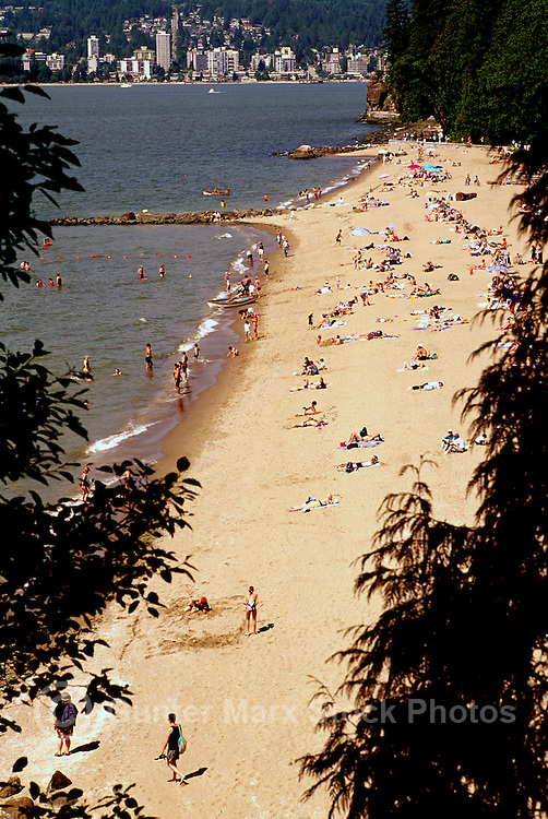 People sunbathing at Third Beach, Stanley Park at English Bay, Vancouver, BC, British Columbia, Canada, Summer