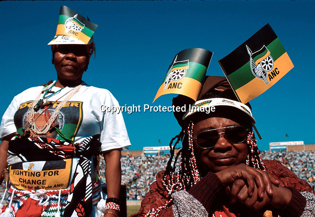 A pre-election ANC rally in April-1999 at FNB stadium in Soweto, South Africa. It was attended by President Nelson Mandela and the (future) deputy President Thabo Mbeki. A traditional Xhosa performance group during the singing of the national anthem. .Photo: Per-Anders Pettersson /iAfrika Photos