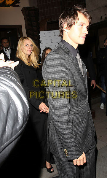 CLAIRE DANES & HUGH DANCY .At the 'Me & Orson Welles' UK film premiere after party at Kanaloa Club, London, England, 18th November 2009..full length half couple grey gray holding hands black peep toe shoes leaving clare suit .CAP/AH.©Adam Houghton/Capital Pictures.