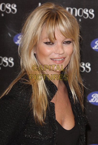 KATE MOSS.Kate Moss launches her new fragrance 'Vintage Muse' at Boots, Oxford Street. London,  November 26th 2010.headshot portrait fringe bangs hair black eyeliner make-up beauty smiling .CAP/ROS.©Steve Ross/Capital Pictures