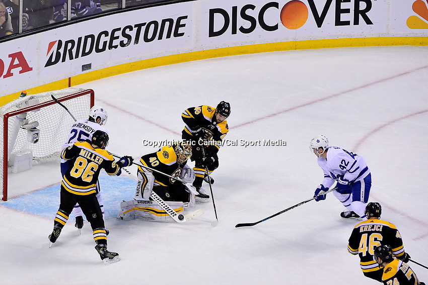 April 21, 2018: Boston Bruins goaltender Tuukka Rask (40) stops a shot by Toronto Maple Leafs center Tyler Bozak (42) during game five of the first round of the National Hockey League's Eastern Conference Stanley Cup playoffs between the Toronto Maple Leafs and the Boston Bruins held at TD Garden, in Boston, Mass. Toronto defeats Boston 4-3, Boston leads Toronto 3 games to 2 in the best of 7 series.