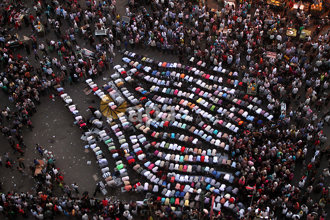 Protesters pray during a protest at Tahrir square in Cairo June 3, 2012. Egyptian pro-democracy campaigners called for a new uprising on Sunday, enraged that a court had spared former leader Hosni Mubarak his life over the killing of protesters during the street revolt that ended his three-decade rule. Photo by Ashraf Amra