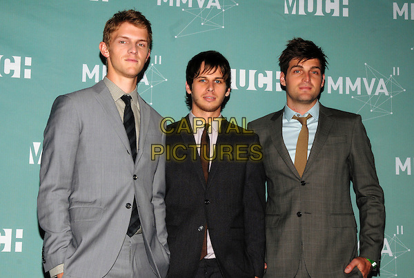 Musicians Mark Pontius, Mark Foster and Cubbie Fink of Foster the People  .The press room at the 22nd Annual MuchMusic Video Awards at the MuchMusic HQ, Toronto, Ontario, Canada..half length black suit jacket stubble facial hair grey gray.CAP/ADM/BPC.©Brent Perniac/AdMedia/Capital Pictures.