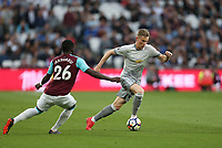 Manchester United's Scott McTominay and West Ham United's Arthur Masuaku<br /> <br /> Photographer Rob Newell/CameraSport<br /> <br /> The Premier League - West Ham United v Manchester United - Thursday 10th May 2018 - London Stadium - London<br /> <br /> World Copyright &copy; 2018 CameraSport. All rights reserved. 43 Linden Ave. Countesthorpe. Leicester. England. LE8 5PG - Tel: +44 (0) 116 277 4147 - admin@camerasport.com - www.camerasport.com