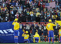 U.S players show their unity during the playing of the national anthem prior to the match with Slovenia. The United States came from a 2-0 halftime deficit to Slovenia to earn a 2-2 draw their second match of play in Group C of the 2010 FIFA World Cup.