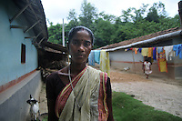 Monika Besra (42)  at Danagram where she lives with her family. Danagram is the village which is 40 kms away from Malda Town,  West Bengal, India. 20th August 2010.  Monica Besra says that her non curable tumour got cured on the first annivarsary of Mother Teresa's death by putting a Mother Teressa Medellion on the swollen part of her abdomen, which was recognized by the Vatican in the year 2002 and started the process of Mother Teresa's beatification, a major step towards sainthood.