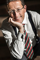 British Journalist of CNN Richard Quest  smiles during a photo session in Santiago, Chile, September 2012...Photo by Roberto Candia