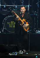 Ali Campbell of UB40 plays the guitar on stage<br /> UB40 concert at Parc Y Scarlets, Llanelli, Wales, UK. Saturday 10 June 2017