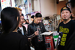 Freddy Lim (L) leader of Taiwanese Heavy Metal band called Chthonic and also lawmaker for New Power Party signs an autograph to a fan in Tokyo on October 13, 2018. Taiwanese band organize a meet and greet event for the release of a new album. October 13, 2018 (Photo by Nicolas Datiche/AFLO) (JAPAN) JAPAN ONLY
