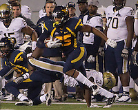 WVU defensive back Darwin Cook (25) returns an interception. The WVU Mountaineers beat the Pitt Panthers 21-20 at Mountaineer Field in Morgantown, West Virginia on November 25, 2011.