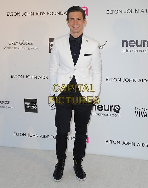 Asher Monroe.The 21st Annual Elton John AIDS Foundation Academy Awards Viewing Party held at The City of West Hollywood Park in West Hollywood, California, USA..February 24th, 2013.oscars full length white suit jacket black trousers hands in pockets tuxedo blue shirt hands in pockets                                                   .CAP/DVS.©DVS/Capital Pictures.