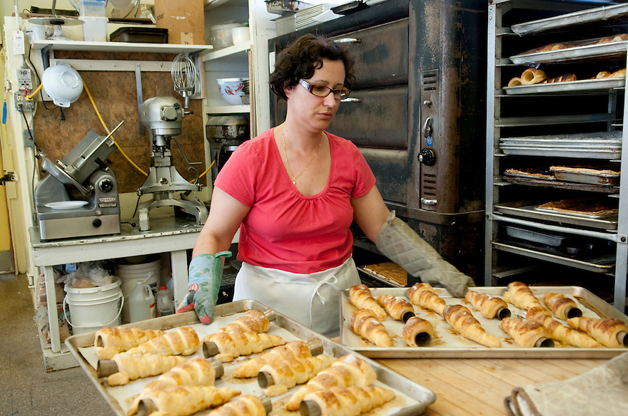 PROVINCETOWN, MA.--May 24, 2010-- Ofelia Bago making pastries at the Portuguese Bakery, which her family has run since 2006. The bakery has been in Provincetown since the 1930s. Bago says she thinks big chain stores would ruin the uniqueness of Provincetown. CREDIT: JODI HILTON FOR THE NEW YORK TIMES