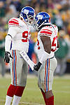 New York Giants linebackers Chase Blackburn (93) and Greg Jones (53) celebrate a special teams tackle during an NFL divisional playoff football game against the Green Bay Packers on January 15, 2012 in Green Bay, Wisconsin. The Giants won 37-20. (AP Photo/David Stluka)