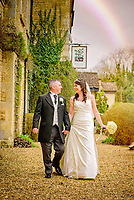 Bride and groom sharing a joke together at the Walnut Tree Inn, Blisworth in Northampton