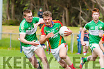 Donnchadh Walsh Mid Kerry goes past Legion's Danny Sheehan during their County SFC round 1 game in Killorglin on Sunday