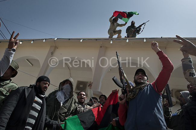 © Remi OCHLIK/IP3 - Bin Jawaad March 27, 2011 - Libyan fighters celebrate as they just took back the city of Bin Jawaad without fighting, they found the city empty from the loyalist Khadafi forces