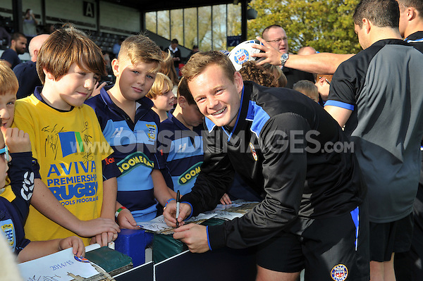 Chris Cook interacts with supporters at the end of the session. Bath Rugby Captain's Run on October 31, 2014 at the Recreation Ground in Bath, England. Photo by: Patrick Khachfe / Onside Images