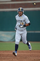 Bryant Miranda #12 of the Coppin State Eagles runs the bases during a game against the Southern California Trojans at Dedeaux Field on February 18, 2017 in Los Angeles, California. Southern California defeated Coppin State, 22-2. (Larry Goren/Four Seam Images)