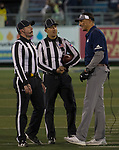 Nevada head coach Jay Norvell talks with referees during their game against Colorado State in Reno, Nev., Saturday, Oct. 27, 2018. (AP Photo/Tom R. Smedes)