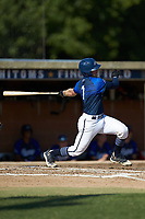 Matthew Suggs (1) (UNC Wilmington) of the Martinsville Mustangs follows through on his swing against the High Point-Thomasville HiToms at Finch Field on July 26, 2020 in Thomasville, NC.  The HiToms defeated the Mustangs 8-5. (Brian Westerholt/Four Seam Images)