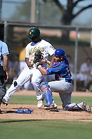 Chicago Cubs catcher Ben Carhart (5) tags out outfielder B.J. Boyd (26) attempting to score during an Instructional League game against the Oakland Athletics on October 16, 2013 at Papago Park Baseball Complex in Phoenix, Arizona.  (Mike Janes/Four Seam Images)