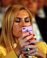 Il sottosegretario alla Pubblica Amministrazione Michaela Biancofiore all'assembea annuale della Confcommercio a Roma, 12 giugno 2013.<br /> Italian Public Function undersecretary Michaela Biancofiore uses her mobile phone during the Italian Confcommercio traders association's annual assembly in Rome, 12 June 2013.<br /> UPDATE IMAGES PRESS/Riccardo De Luca