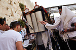Jerusalem. Praying men carry a torah at the Kotel, the Western Wall during a Bar Mitzvah celebration.