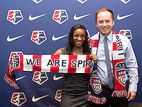 #1 overall pick Crystal Dunn of the Washington Spirit stands with head coach Mark Parsons during the NWSL draft at the Pennsylvania Convention Center in Philadelphia, PA, on January 17, 2014.