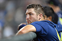 Left fielder Tim Tebow (15) of the Columbia Fireflies in a game against the West Virginia Power on Thursday, May 18, 2017, at Spirit Communications Park in Columbia, South Carolina. Columbia won in 10 innings, 3-2. (Tom Priddy/Four Seam Images)