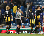 The players congratulate assistant referee Lorraine Clark at the end of the match
