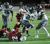 NWA Democrat-Gazette/ANDY SHUPE<br /> Luke Rapert (22) of Fayetteville bowls over Kenneth Lane (23) of Springdale Friday, Oct. 9, 2015, on his way to the end zone during the first half of play at Jarrell Williams Bulldog Stadium in Springdale. Visit nwadg.com/photos to see more photographs from the game.