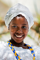 A young Baiana girl smiles during the ritual ceremony in honor to Yemanjá, the Candomblé goddess of the sea, in Cachoeira, Bahia, Brazil, 5 February 2012. Yemanjá, originally from the ancient Yoruba mythology, is one of the most popular ?orixás?, the deities from the Afro-Brazilian religion of Candomblé. Every year on February 5th, hundreds of Yemanjá devotees participate in a colorful celebration in her honor. Faithful, usually dressed in the traditional white, gather on the banks of Paraguaçu river to leave offerings for their goddess. Gifts for Yemanjá include flowers, perfumes or jewelry. Dancing in the circle and singing ancestral Yoruba prayers, sometimes the followers enter into a trance and become possessed by the spirits. Although Yemanjá is widely worshipped throughout Latin America, including south of Brazil, Uruguay, Cuba or Haiti, the most popular cult is maintained in Bahia, Brazil.