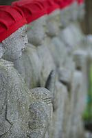A line of Buddhist Jizo statues at a temple in Narai-juku, Kiso Valley, Nagano, Japan.