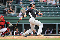 Third baseman Joey Gallo (30) of the Hickory Crawdads breaks his bat in a game against the Greenville Drive on Sunday, June 9, 2013, at Fluor Field at the West End in Greenville, South Carolina. Gallo is the No. 10 prospect of the Texas Rangers, according to Baseball America and was a first-round pick (39th overall) in the 2012 First-Year Player Draft. The catcher is the Drive's Jayson Hernandez. Hickory won, 6-3. (Tom Priddy/Four Seam Images)