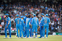 The Indian players gather following the wicket of Marcus Stones (Australia) during India vs Australia, ICC World Cup Cricket at The Oval on 9th June 2019