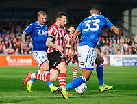 Lincoln City's Neal Eardley vies for possession with Macclesfield Town's Elliott Durrell, left, and Macclesfield Town's Zak Jules<br /> <br /> Photographer Chris Vaughan/CameraSport<br /> <br /> The EFL Sky Bet League Two - Lincoln City v Macclesfield Town - Saturday 30th March 2019 - Sincil Bank - Lincoln<br /> <br /> World Copyright © 2019 CameraSport. All rights reserved. 43 Linden Ave. Countesthorpe. Leicester. England. LE8 5PG - Tel: +44 (0) 116 277 4147 - admin@camerasport.com - www.camerasport.com