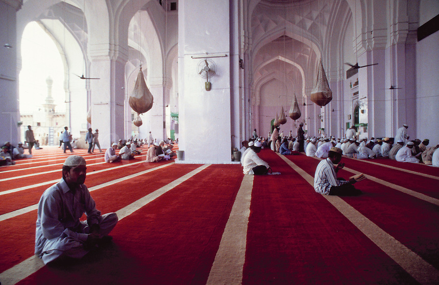 A crowd of Friday worshippers at the Mecca Masjid mosque. Hyderabad, India.