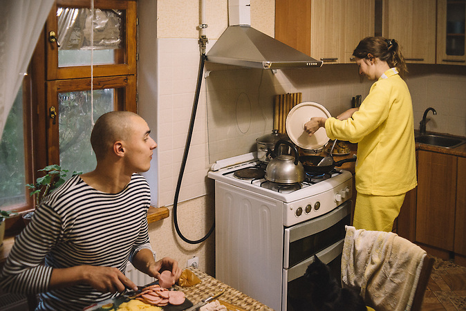 Katerine and Alexander cooking dinner during Alexanders day of millitary service. Ribnita, Transnistria